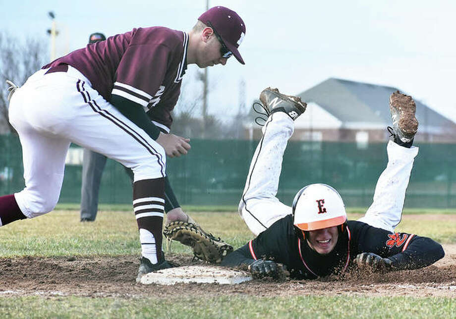 Edwardsville's Joe Copeland dives safely back into first base on a pickoff attempt by Moline during Monday's game at Tom Pile Field in Edwardsville. Photo: Matt Kamp / Hearst Illinois