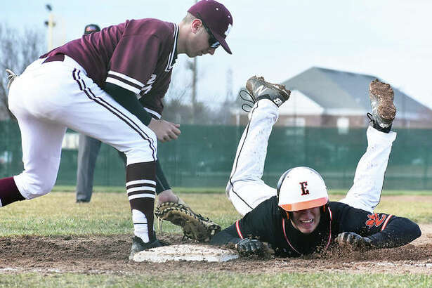 Edwardsville's Joe Copeland dives safely back into first base on a pickoff attempt by Moline during Monday's game at Tom Pile Field in Edwardsville.