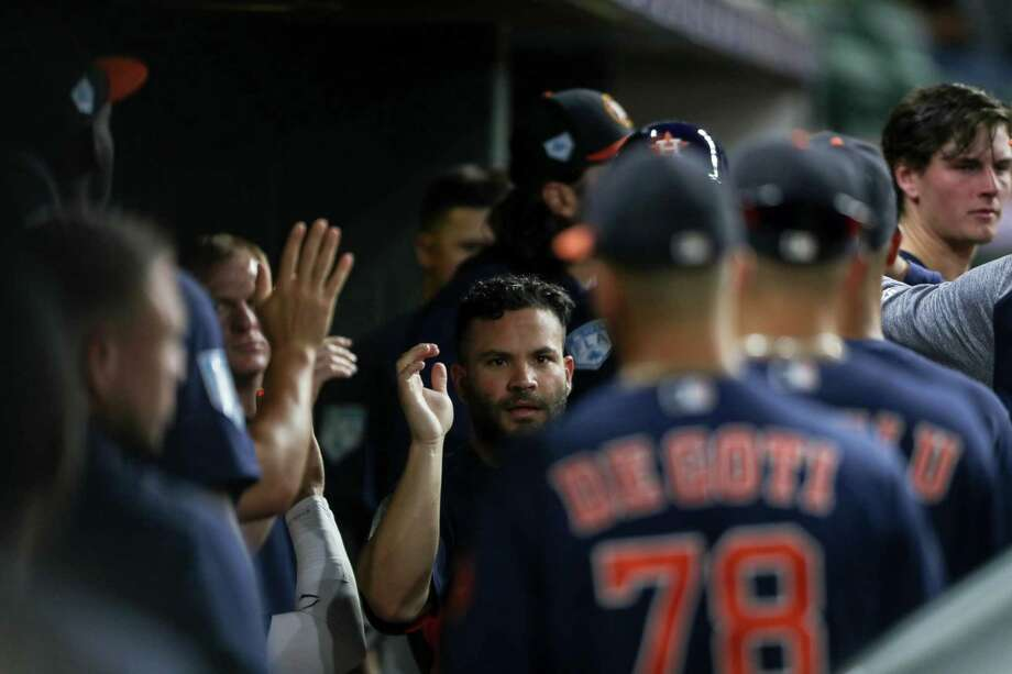 Houston Astros second baseman Jose Altuve (27) is congratulated by teammates after scoring on a single by left fielder Michael Brantley (23) during the third inning of a spring training game at Minute Maid Park on Monday, March 25, 2019, in Houston. Photo: Jon Shapley, Staff Photographer / © 2019 Houston Chronicle