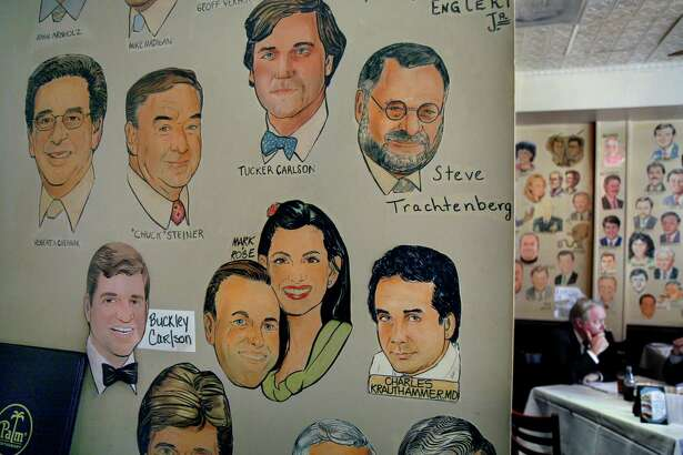 The walls of the Palm restaurant in Washington, shown in 2007, are covered with the faces of famous people and regular customers.
