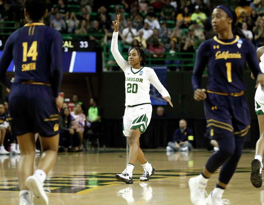 Baylor guard Juicy Landrum (20) celebrates after sinking a three-point basket as California guard Kianna Smith (14) and Asha Thomas (1) look on in the second half of a second-round game in the NCAA women's college basketball tournament in Waco, Texas, Monday, March 25, 2019. (AP Photo/Tony Gutierrez) Photo: Tony Gutierrez, Associated Press / Copyright 2019 The Associated Press. All rights reserved.