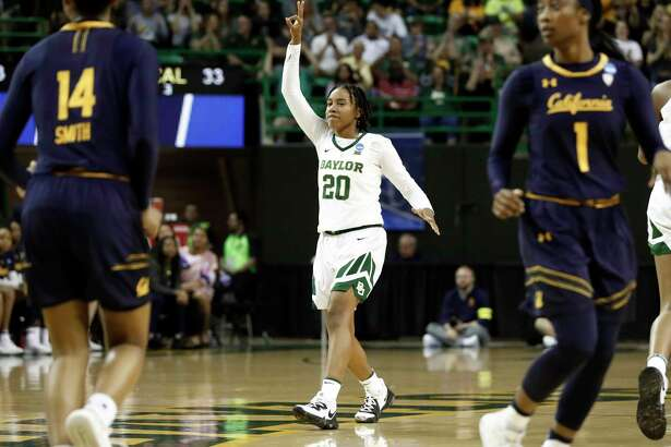 Baylor guard Juicy Landrum (20) celebrates after sinking a three-point basket as California guard Kianna Smith (14) and Asha Thomas (1) look on in the second half of a second-round game in the NCAA women's college basketball tournament in Waco, Texas, Monday, March 25, 2019. (AP Photo/Tony Gutierrez)