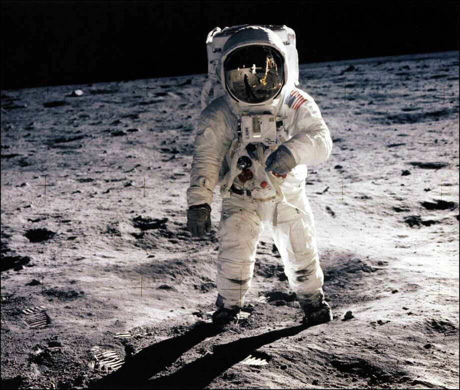 "This July 20, 1969, photo shows astronaut Edwin E. Aldrin Jr. walking on the surface of the moon near the leg of the Lunar Module (ML) ""Eagle"" during the Apollo 11 extravehicular activity (EVA). AFP PHOTO / NASA/HANDOUT Photo: HO, Handout / AFP/Getty Images / AFP"
