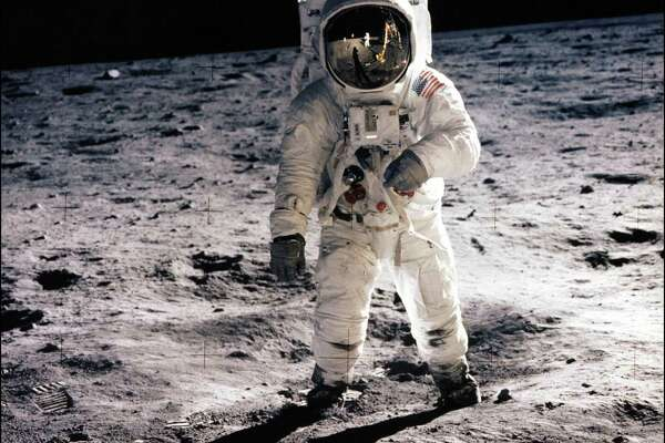 """This July 20, 1969, photo shows astronaut Edwin E. Aldrin Jr. walking on the surface of the moon near the leg of the Lunar Module (ML) """"Eagle"""" during the Apollo 11 extravehicular activity (EVA). AFP PHOTO / NASA/HANDOUT"""