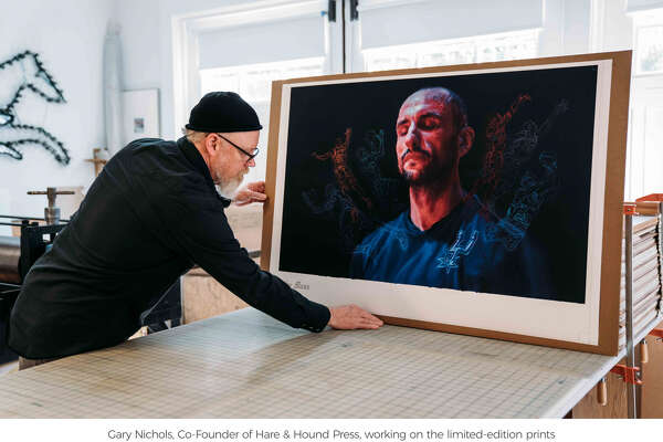 """San Antonio artist Vincent Valdez with his work, titled """"Manu,"""" created and released for the Spurs' legend's jersey retirement."""