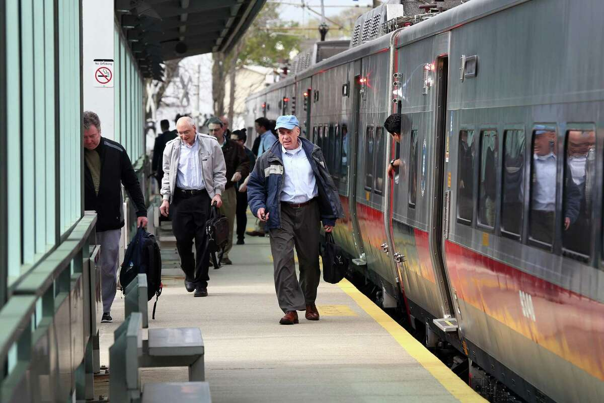Commuters get off the Metro North train at the Springdale train station.