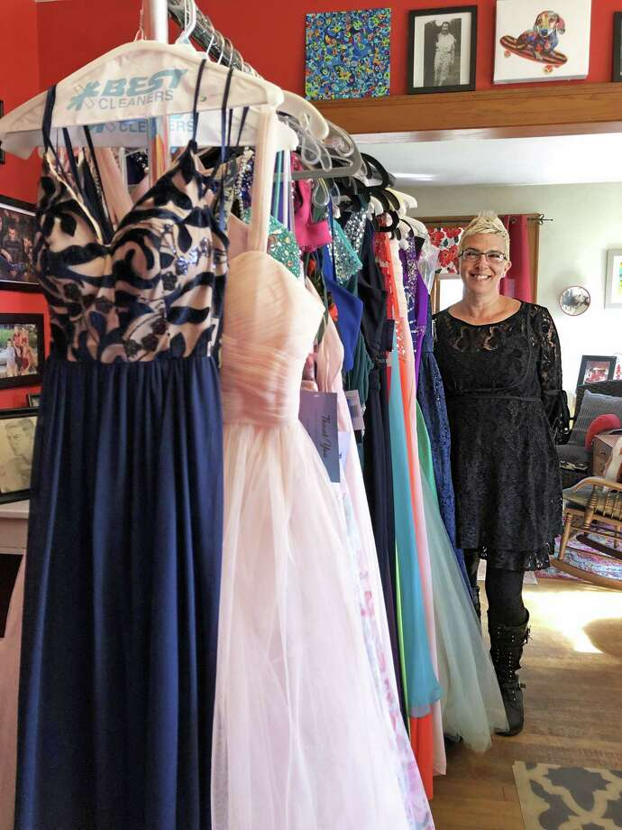 Jill Deane, founder of Perfect Prom of CT, has an array of gowns high schoolers can choose from to wear to their class ball. Deane launched her project 10 years ago after realizing her daughter's prom dresses were going to waste sitting in her closet. Photo: Emily Disalvo Photo