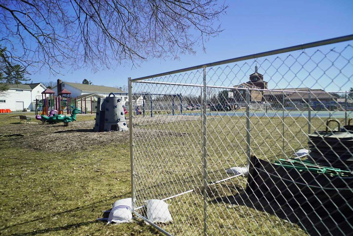 A fence has been erected around a construction area at the New York State Department of Corrections and Community Supervision Training Academy on Tuesday, March 26, 2019, in Albany, N.Y. Neighborhood residents are upset because they say they were never notified of the expansion and so did not have the chance to voice their concerns about the expansion and what impact it would have on the neighborhood. (Paul Buckowski/Times Union)