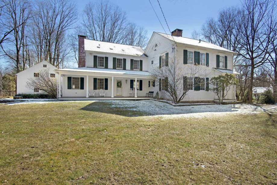 The updated antique colonial farmhouse at 87 Partrick Road was built in 1823 by Lewis Partrick, one of Westport's founding fathers. Photo: VHT Studios - Www.VHT.com / ©2019 VHT Studios All rights reserved