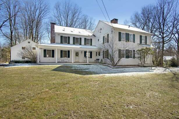 The updated antique colonial farmhouse at 87 Partrick Road was built in 1823 by Lewis Partrick, one of Westport's founding fathers.
