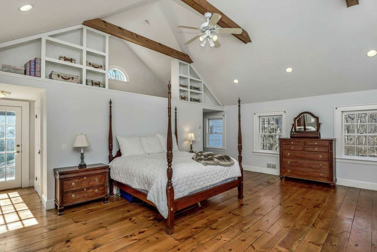 The master bedroom suite has a marble fireplace and built-in bookshelves.