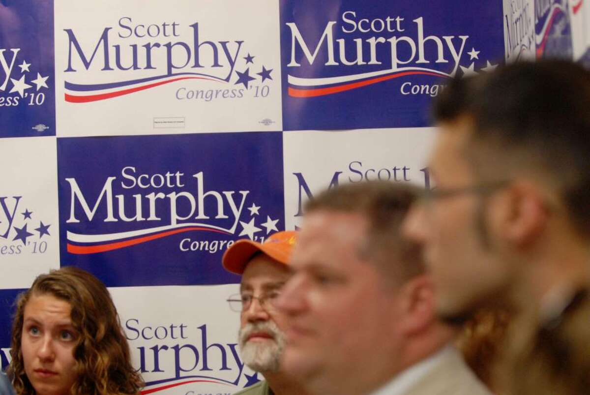 Supporters of Congressman Scott Murphy listen as he addresses them during an event at his campaign headquarters in Clifton Park on Sunday, July 25, to officially kick off his reelection campaign. (Paul Buckowski / Times Union)