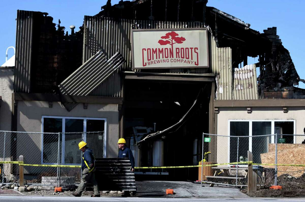 Workers remove debris form the Commons Roots Brewing Company following a fire on Tuesday, March 26, 2019, on Saratoga Avenue in South Glens Falls, N.Y. The fire started on Monday night. (Will Waldron/Times Union)