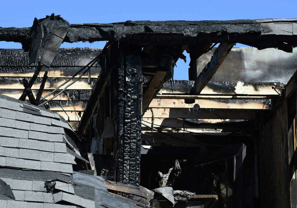 The upper floor and roof in the front section of Commons Roots Brewing Company was destroyed following a fire on Tuesday, March 26, 2019, on Saratoga Avenue in South Glens Falls, N.Y. The fire started on Monday night. (Will Waldron/Times Union)