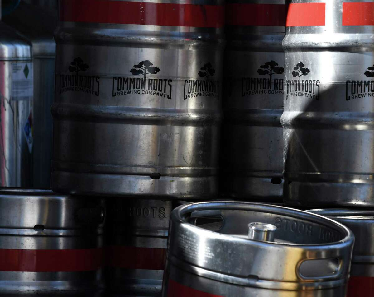 Kegs are stored outside after fire ripped through the Commons Roots Brewing Company on Tuesday, March 26, 2019, on Saratoga Avenue in South Glens Falls, N.Y. The fire started on Monday night. (Will Waldron/Times Union)