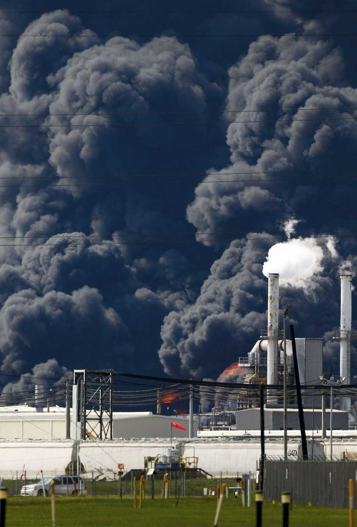 Firefighters continue to battle the petrochemical fire at Intercontinental Terminals Company, which grew in size due to a lack of water pressure last night Tuesday, March 19, 2019, in Deer Park, Texas. (Godofredo A. Vasquez/Houston Chronicle via AP)