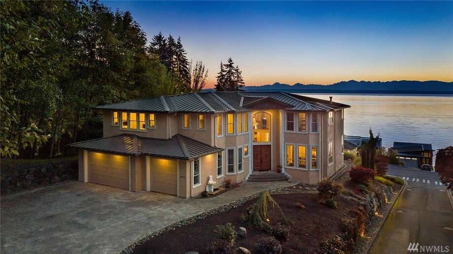 Overlooking the Puget Sound, this 5,783 square foot residence has views to spare. Boasting 5 bedrooms and 4.5 baths, a wine cellar and a large deck, among other amenities. The home is listed for $2.75 million. Photo: Photo Credit: Nolan King