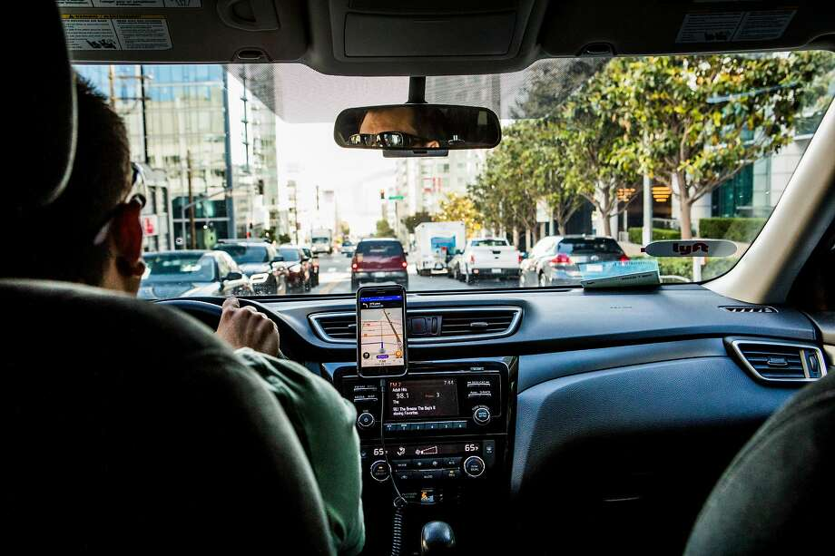 FILE — A Lyft driver in San Francisco, June 14, 2017. A new analysis on the traffic impact of Uber and Lyft shows that the amount of miles traveled by vehicles working for the two companies might have doubled from 2016 to 2018. And the two companies contribute more to the total miles driven by vehicles in San Francisco than they do in any other major cities examined in the study. Photo: Christie Hemm Klok, NYT