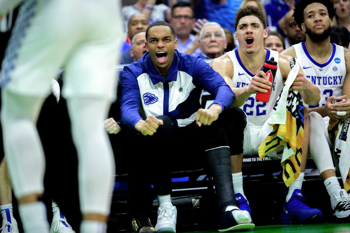 Kentucky's PJ Washington, left, wearing a cast on his left foot sits on the bench during the second half against Abilene Christian in a first-round game in the NCAA men's college basketball tournament Thursday, March 21, 2019, in Jacksonville, Fla. (AP Photo/Stephen B. Morton)
