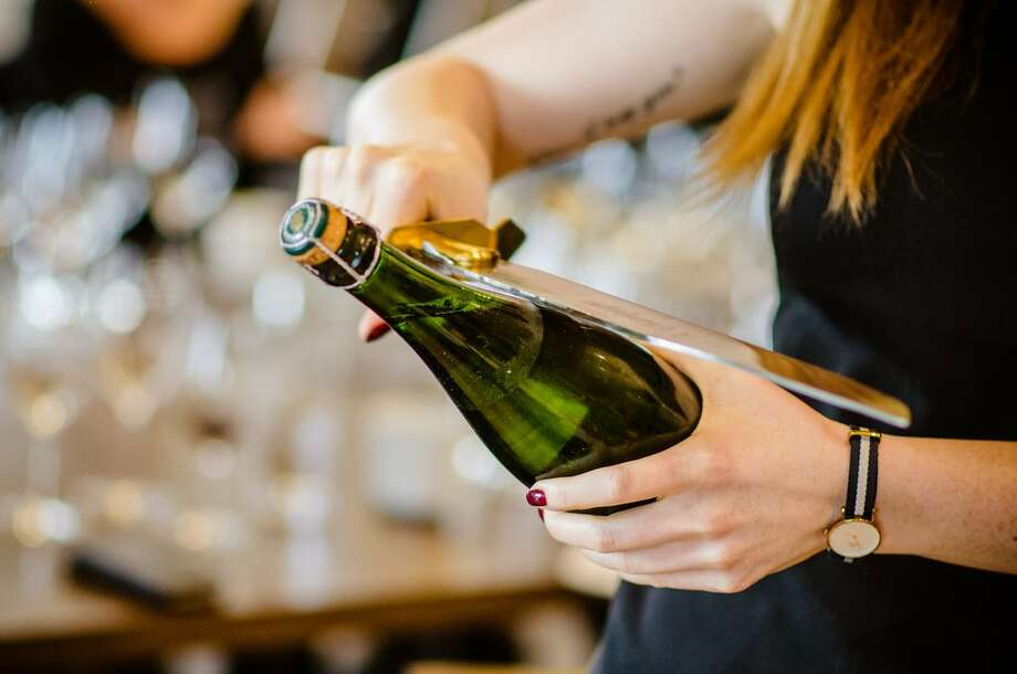Using a saber or sword to uncork champagne bottles will be taught at a'Bouzy restaurant during its Saber Sunday parties beginning March 31. Photo: Tanglewoodwine.co.uk