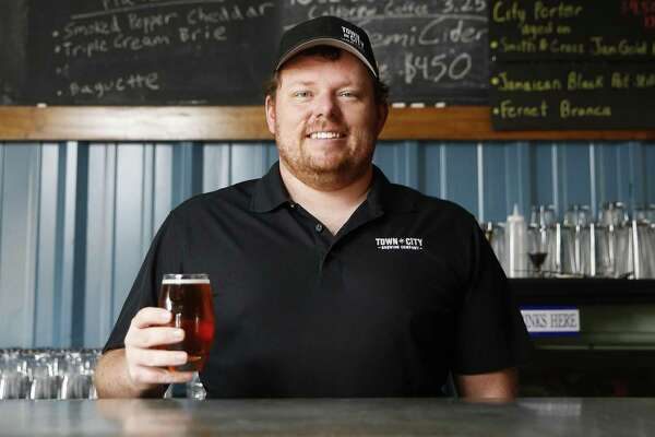 Town in City Brewing Co. owner Justin Engle stands in his tasting room in the Heights Wednesday, Dec. 13, 2017 in Houston.( Michael Ciaglo / Houston Chronicle)