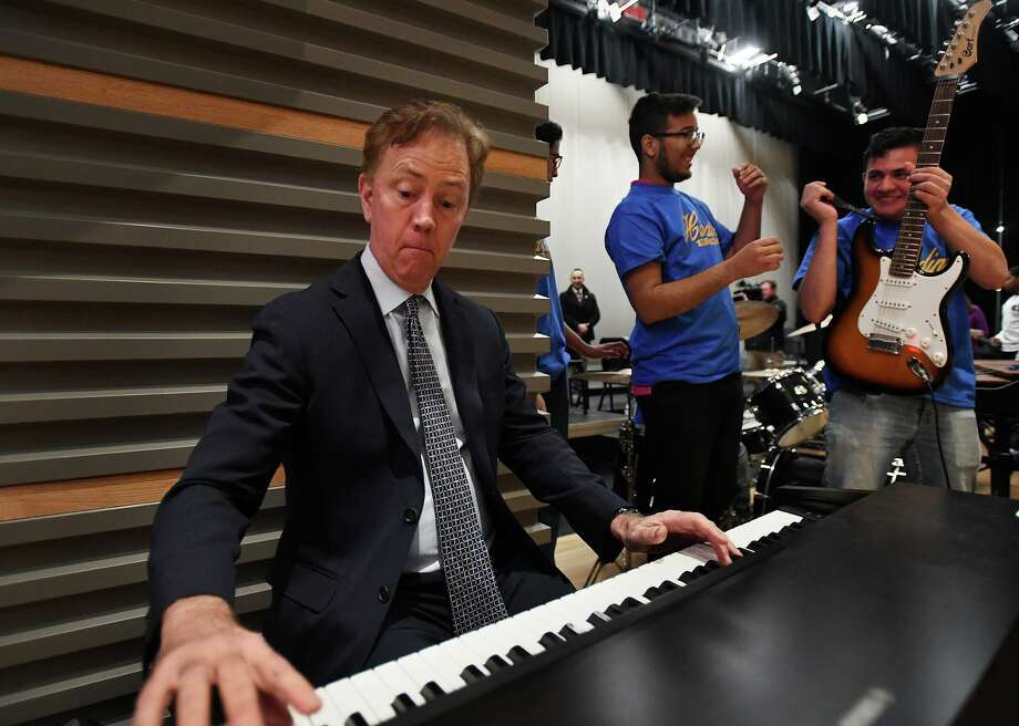 Governor Ned Lamont hops on the keyboards for an impromptu jam with the Harding High School Rock Band during a visit to the school in Bridgeport on Tuesday. Photo: Brian A. Pounds / Hearst Connecticut Media / Connecticut Post