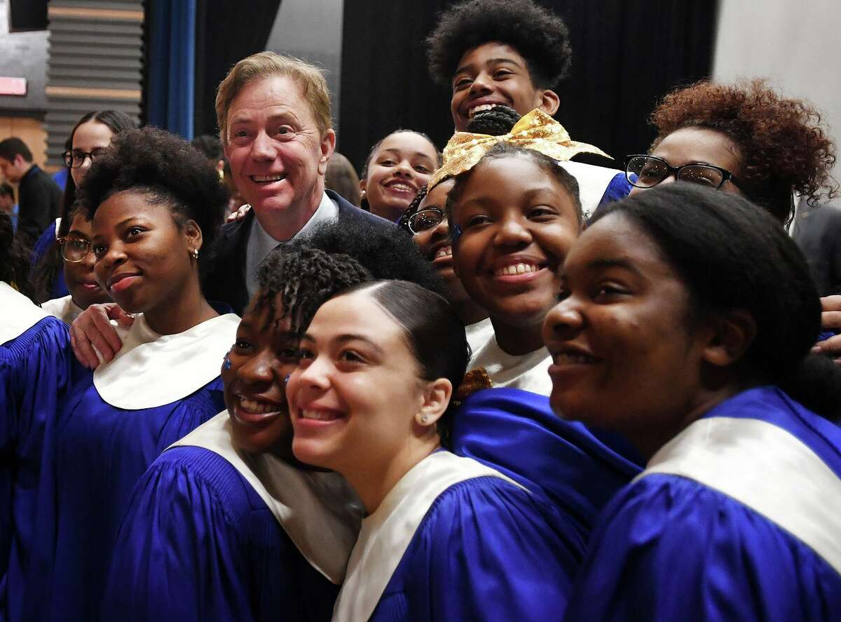 Governor Ned Lamont poses for a photo with the Harding High School Choir during a visit to the school in Bridgeport, Conn. on Tuesday, March 26, 2019.