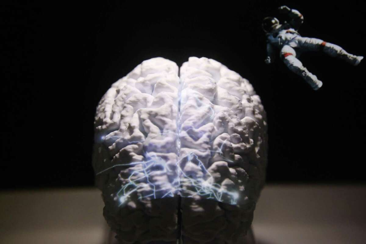 A model of a human brain is used to illustrate the flexible graphene technology used for the mapping of brain activity on a stand during the opening day of the MWC Barcelona in Barcelona, Spain, on Monday, Feb. 25, 2019. At the wireless industry's biggest conference, over 100,000 people are set to see the latest innovations in smartphones, artificial intelligence devices and autonomous drones exhibited by more than 2,400 companies. Photographer: Angel Garcia/Bloomberg