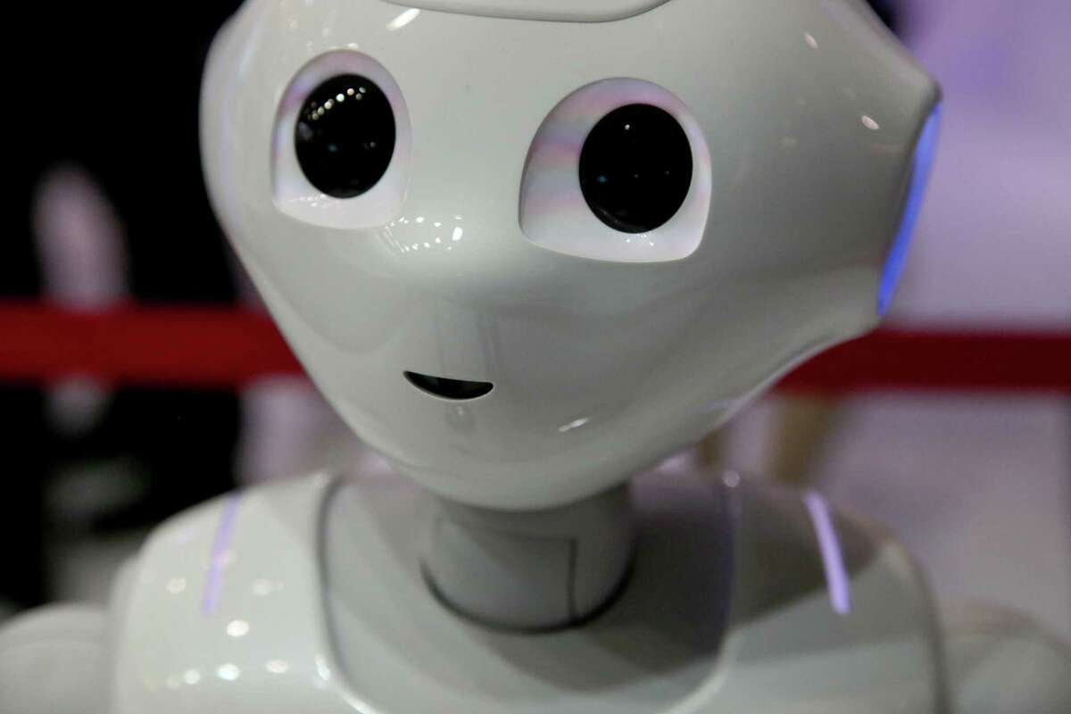 A SoftBank Group Corp. Pepper humanoid robot is demonstrated on the CloudMinds Technology Inc. stand on day two of the MWC Barcelona in Barcelona, Spain, on Tuesday, Feb. 26, 2019. At the wireless industry's biggest conference, over 100,000 people are set to see the latest innovations in smartphones, artificial intelligence devices and autonomous drones exhibited by more than 2,400 companies. Photographer: Angel Garcia/Bloomberg