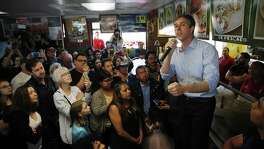 Democratic presidential candidate and former Texas congressman Beto O'Rourke, right, speaks during a campaign stop a restaurant Sunday, March 24, 2019, in Las Vegas. (AP Photo/John Locher)