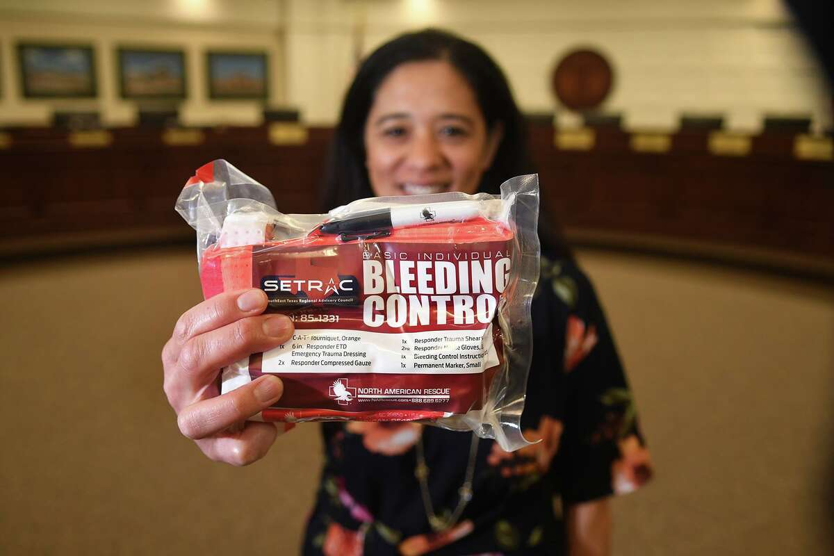 Cathy Pool, Tomball ISD Director of Health Services, shows off one of the Stop the Bleed kits that was part of the ceremonial announcement of the donation of the necessary kits for TISD and the training to go with those during an event held in the TISD's administrative building board room on March 25, 2019.