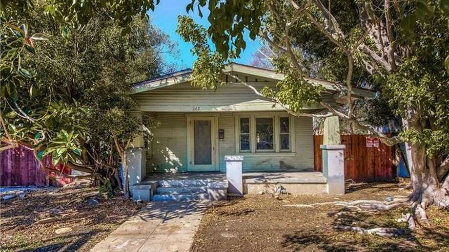 A rat-infested hoarder house in SoCal's Orange County was sold for $55,000 over asking. Here's why it started a bidding war and how much a reno will cost. Photo: Realtor.com
