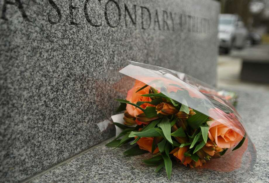 A bouquet of roses is left one of the granite benches outside Edmond Town Hall in Newtown, CT on Monday, March 25, 2019. The building is home to the Avielle Foundation, where Jeremy Richman, father of Sandy Hook victim Avielle Richman, was found dead from an apparent suicide early Monday. Photo: Brian A. Pounds / Hearst Connecticut Media / Connecticut Post