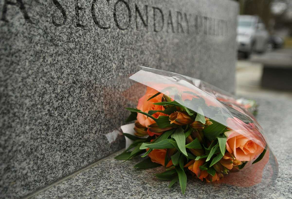 A bouquet of roses is left one of the granite benches outside Edmond Town Hall in Newtown, CT on Monday, March 25, 2019. The building is home to the Avielle Foundation, where Jeremy Richman, father of Sandy Hook victim Avielle Richman, was found dead from an apparent suicide early Monday.