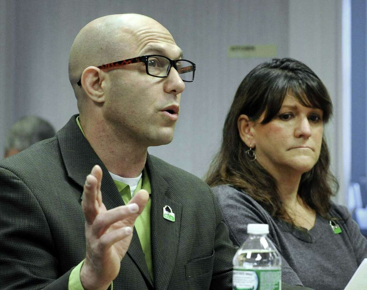 Jeremy Richman and Jennifer Hensel , parents of shooting victim Avielle Richman testify before the Sandy Hook Advisory Commission, Friday, Nov. 14, 2014, at the C.H. Booth Library in Newtown, Conn.