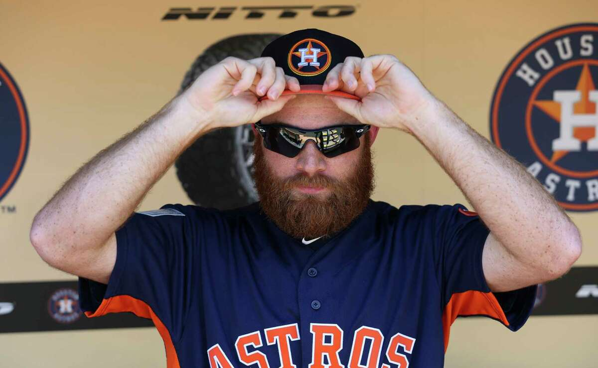 PHOTOS: Houston Astros fan giveaways for 2019 season  Houston Astros right-handed pitcher Cy Sneed (70) puts his hat on before the MLB exhibition game against the Pittsburgh Pirates at Minute Maid Park on Tuesday, March 26, 2019, in Houston.  >>>See the remaining fan giveaways and freebies during the Astros' 2019 season ...