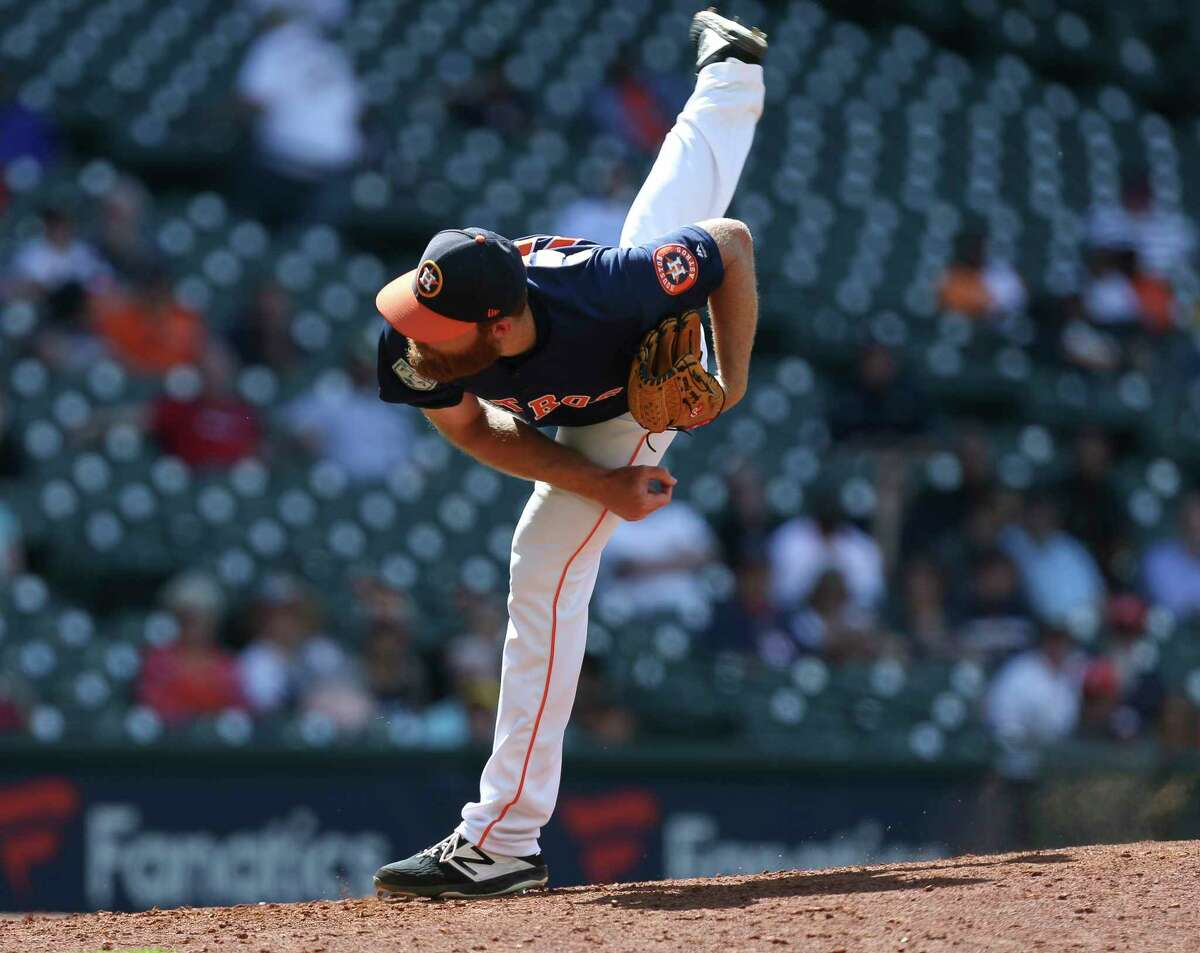 Houston Astros right-handed pitcher Cy Sneed (70) pitches during the top ninth inning of the MLB exhibition game against the Pittsburgh Pirates at Minute Maid Park on Tuesday, March 26, 2019, in Houston.