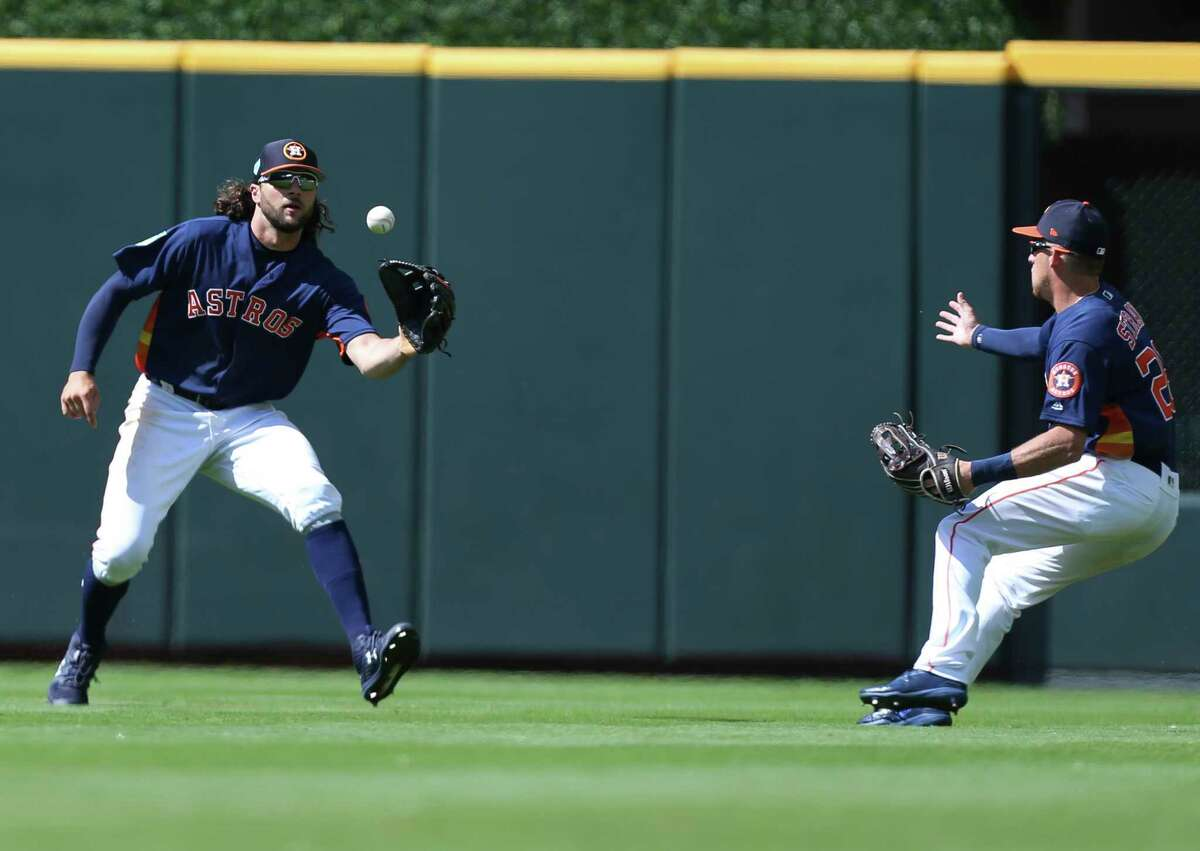 Houston Astros outfielders Jake Marisnick (6) and Myles Straw go after a Pittsburgh Pirates hit during the top ninth inning of the MLB exhibition game at Minute Maid Park on Tuesday, March 26, 2019, in Houston.