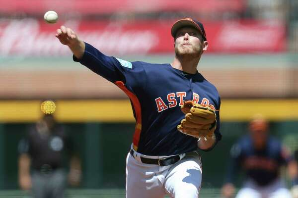 Houston Astros starting pitcher J.B. Bukauskas (69) pitches during the top second inning of the MLB exhibition game against the Pittsburgh Pirates at Minute Maid Park on Tuesday, March 26, 2019, in Houston.