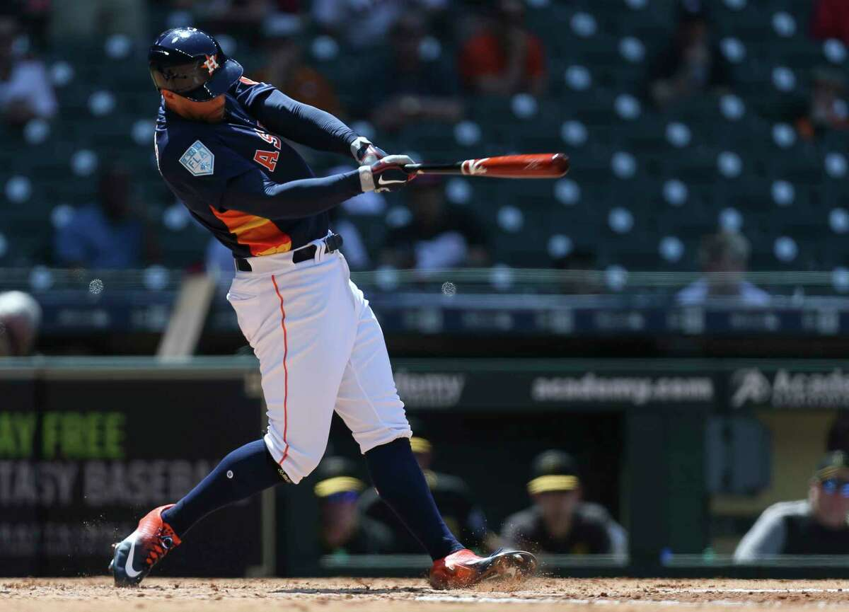 Astros center fielder George Springer (4) slugs a solo home run during the bottom of the fourth inning against the Pirates on Tuesday at Minute Maid Park.