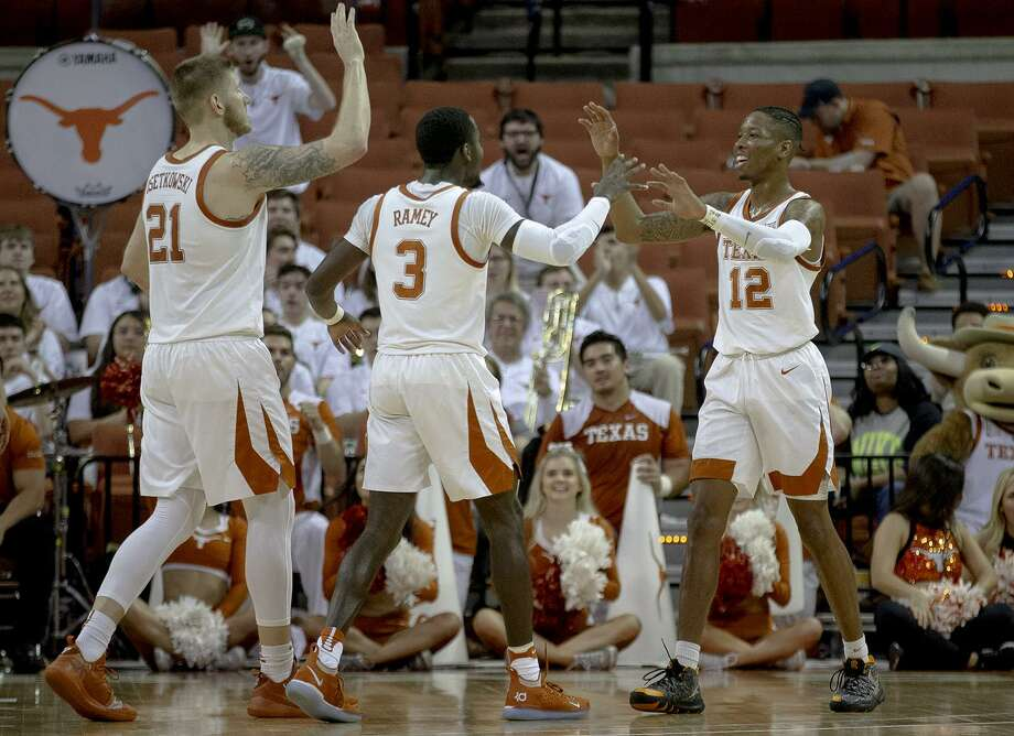 Texas guard Kerwin Roach II (12) celebrates a score with forward Dylan Osetkowski (21) and guard Courtney Ramey (3) during an NCAA college basketball game in the second round of the NIT on Sunday, March 24, 2019, in Austin, Texas. (Nick Wagner/Austin American-Statesman via AP) Photo: Nick Wagner, MBO / Associated Press / Austin American-Statesman
