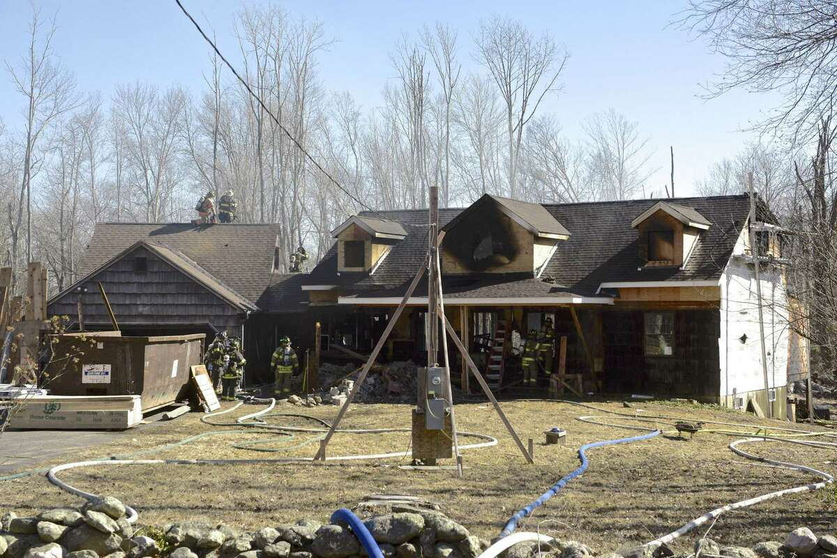 The Brookfield Volunteer Fire Department worked with multiple departments from throughout the area to extinguish a house fire on Parker Hill Road in Brookfield, Conn, on Tuesday afternoon, March 26, 2019.