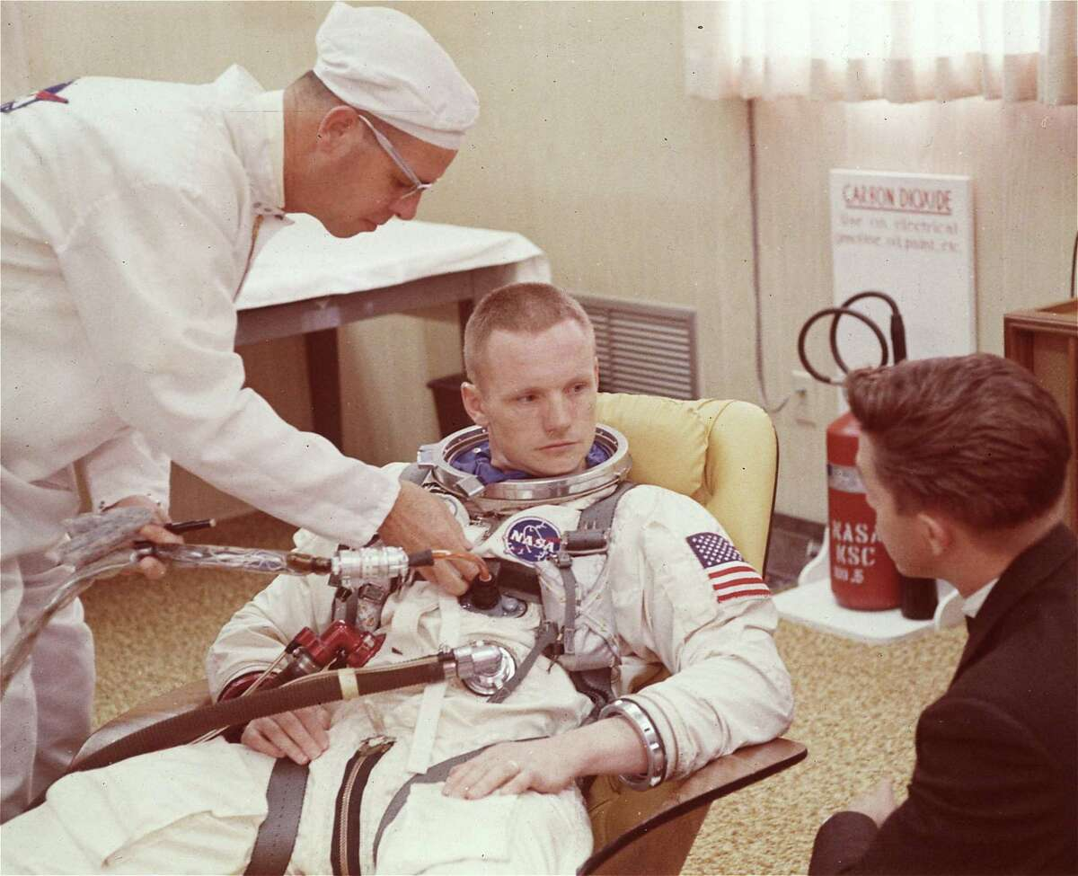 Neil Armstrong is seated during a suiting up exerciseon March 9, 1966, in Cape Kennedy, Fla., in preparation for the Gemini 8 flight.