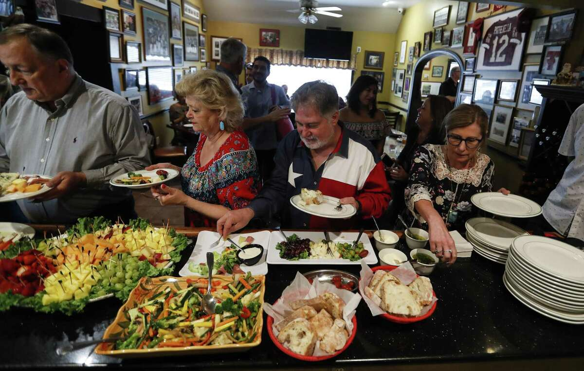 Cindy and Tim Moudry sample food from Patrenella's Italian restaurant during an Italian-themed food tour, led by author Paul Galvani and Food Tours of Houston owner/operator Will Springfield, Saturday, March 23, 2019, in Houston.