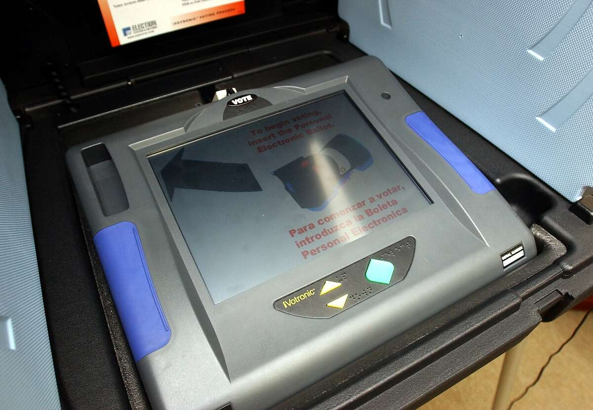 METRO -The Votronic electronic voting machine, which weighs about nine pounds, is being considered for use in Bexar County. This one was on display at the Bexar County Courthouse on Tuesday afteroon. BILLY CALZADA / STAFF