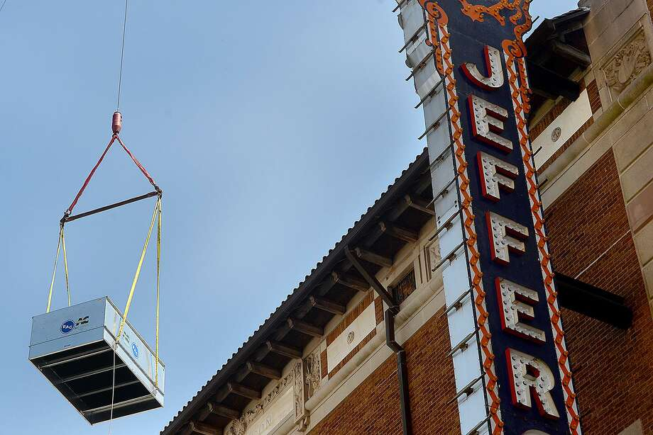 Workers install a new cooling tower on top of the Jefferson Theatre Tuesday. Replacing the old unit is part of the maintenance and upgrades being made to the building. Photo taken Tuesday, March 26, 2019 Kim Brent/The Enterprise Photo: Kim Brent / The Enterprise / BEN