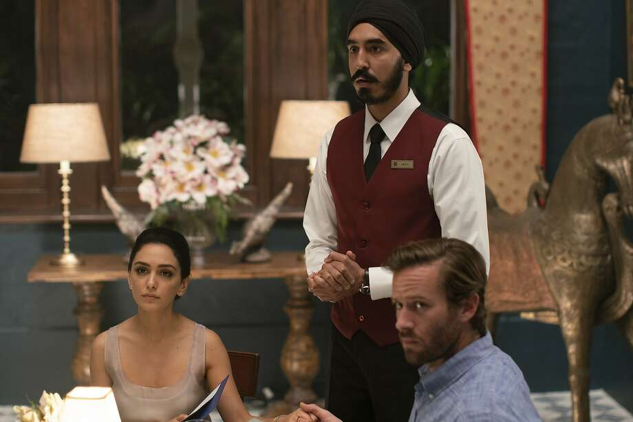 "This image released by Bleecker Street shows Nazanin Boniadi, from left, Dev Patel and Armie Hammer in a scene from ""Hotel Mumbai."" (Mark Rogers/Bleecker Street via AP) Photo: Mark Rogers, Associated Press"