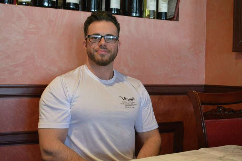 Eduard Seferi, 32, the owner of Vinny's Restaurant, plans to move the business from East Main Street to East Elm Street in mid-August. Photo: Leslie Hutchison / Hearst Connecticut Media /