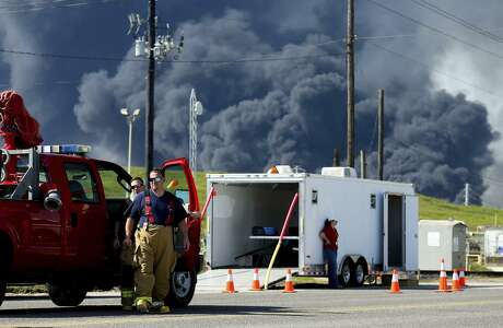Firefighters arrive at the site where the Intercontinental Terminals Company petrochemical fire reignited, Friday, March 22, 2019, in Deer Park, Texas.