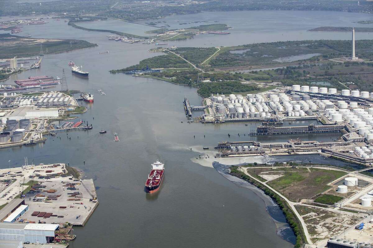 Maritime traffic moves through the Houston Ship Chanel past the site of now-extinguished petrochemical tank fire at Intercontinental Terminals Company on Wednesday, March 20, 2019, in Deer Park. Air quality and water pollution from the fire's runoff, seen on the right, into the ship channel are some of the concerns in the aftermath of the blaze.
